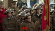 Armistice Day marked WALES Caernarfon Children wearing WWI / WWII soldiers' uniforms stand for minute's silence at Armistice Day ceremony