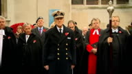 Prince Philip visit to Westminster Abbey CU Prince Philip's cross on bed of poppies TILT UP to Duke of Edinburgh as bugle sounds NATSOT Woman reading...