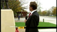 World War I soldier honoured with statue in Barking ENGLAND Essex Barking EXT Reporter to camera Veterans with flags Brian and Barry Moody standing...