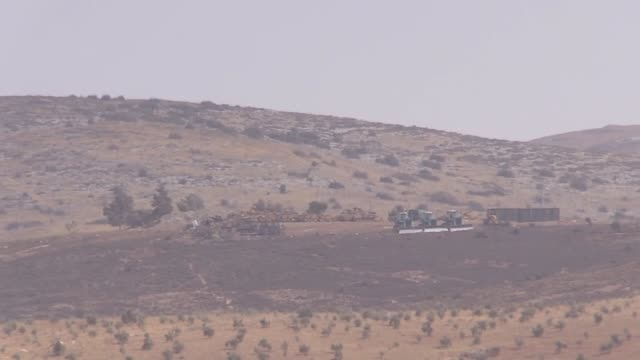 Armored Turkish military vehicles are seen being moved to the Syrian border on October 8 2017 near Reyhanli district of Hatay province southern...