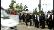 Arms Fair disrupted by protest against weapons industry ENGLAND London Excel Centre EXT Close shot tape cordon reading 'Warning Arms Trade at Work...