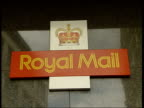 Arms of postal worker folded across chest Postal workers outside sorting office 'Royal Mail' sign outside building Alan Smith interviewed SOT Anger...