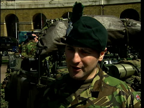 Army barracks in Chelsea holds open day ITN London Chelsea Territorial Army soldier chatting to people at recruitment stall MS Soldier chatting to...