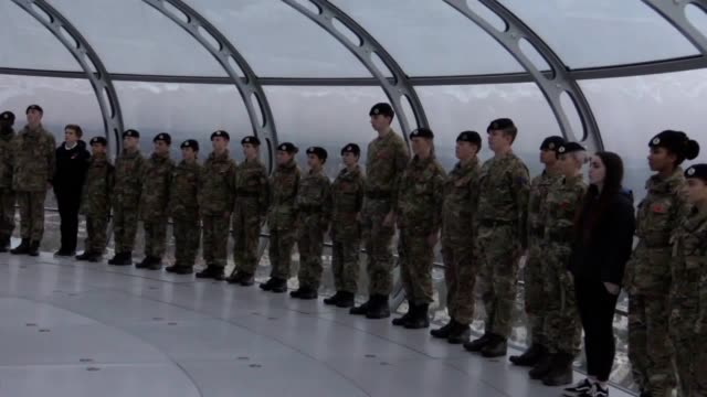 Army cadets military personnel veterans and relatives mark the twominute silence at 11am on Armistice Day atop the world's tallest moving observation...