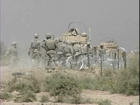 Army engineers building barbed wire fence during construction at Patrol Base Hawkes / Arab Jabour Iraq / AUDIO
