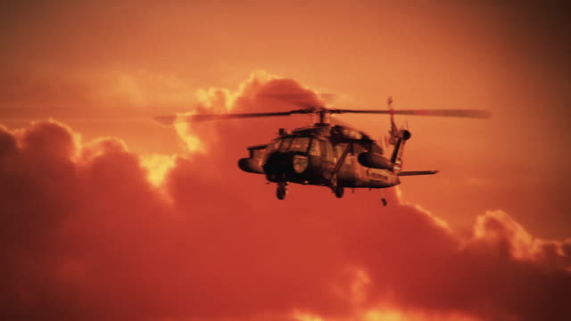 Army Helicopter on sunset background