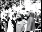 Army officers clergymen and Tsar Nicholas II meeting and kissing on cheeks during Easter celebrations / Russia