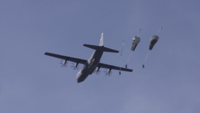 US Army paratroopers assigned to 1st Squadron 91st Cavalry Regiment 173rd Airborne Brigade conduct an airborne operation from US Air Force C130...