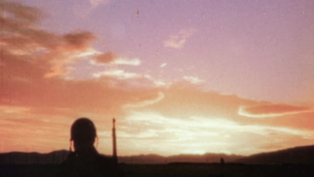 S Army soldier watching a lavender and orange sunset during Operation Torch / Tunisia