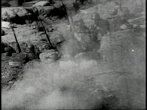REENACTMENT US Army soldiers firing rifles, then climbing from trenches to charge / Western Front
