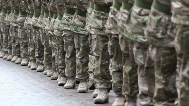 Army Soldiers in line marching at a Military homecoming parade