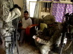Army soldiers interrogating man in his home during patrol / Baghdad Iraq / AUDIO