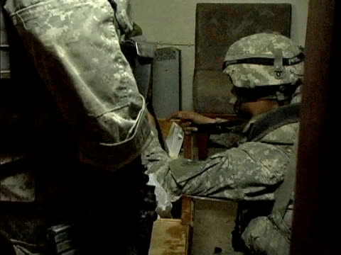 Army soldiers searching through dresser drawers in house / Baghdad Iraq / AUDIO