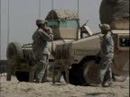 Army soldiers standing near armored vehicles at Patrol Base Hawkes / Arab Jabour Iraq / AUDIO