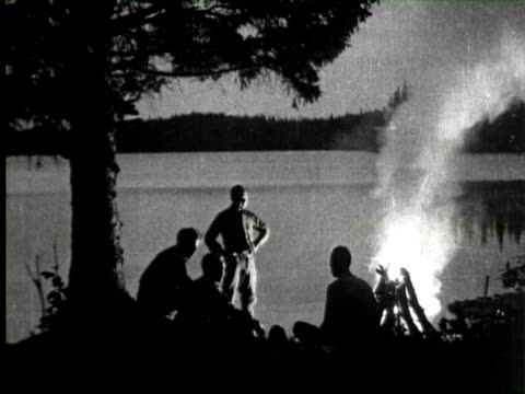 Army taking rest at bank of river in night, United States / AUDIO