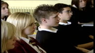 Army to advise on discipline and motivation in Trust Schools ENGLAND Essex INT Back view schoolchildren putting up hands to answer questions in...