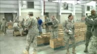 Army volunteers package food items in boxes to deliver to charities in New York State New York State Partners with Walmart PepsiCo and FreshDirect to...