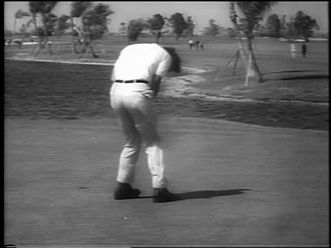 Arnold Palmer putting in wind at Ninth Hole at DoralRyder Open Miami / newsreel
