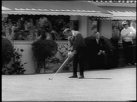 Arnold Palmer teeing off in front of clubhouse at US Open / San Francisco / newsreel