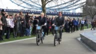 Arnold Schwarzenegger and Boris Johnson ride their bicycles as part of the photo call at Potter's Field to promote Barclays green energy Arnold...