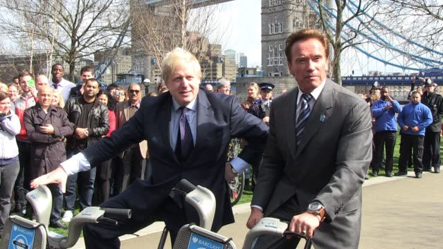 Arnold Schwarzenegger and Boris Johnson talk to the press as part of the photo call at Potter's Field to promote Barclays green energy Arnold...