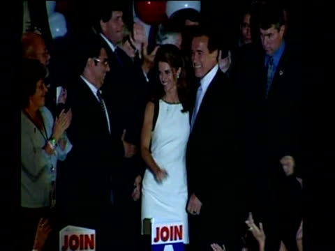 Arnold Schwarzenegger and his wife arrive on stage to cheering crowds after becoming the new Governor of California October 2003
