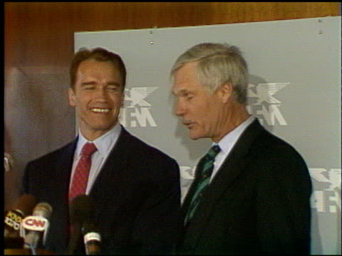 Arnold Schwarzenegger at the AFM Press Conference with Ted Turner at AFM on March 3 1992