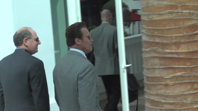 Arnold Schwarzenegger entering press conference at the MIP TV Conference Day 2