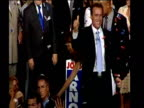 Arnold Schwarzenegger shakes hands and waves to supporters after becoming the new Governor of California October 03