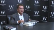 Arnold Schwarzenegger signs copies of his book while promoting his autobiography Total Recall Arnold Schwarzenegger at Waterstone's Piccadilly on...