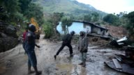 Around 100 people were buried alive in a tea growing region of Sri Lanka Wednesday as mudslides triggered by monsoon rains washed away their homes on...