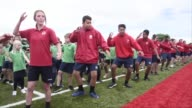 Around 7000 New Zealand schoolchildren stomp and bellow their way through what is believed to be the largestever haka claiming a new world record for...