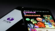 Arranged close shot the Puzzle Dragons smartphone game developed by GungHo Online Entertainment Inc is played on an Apple Inc iPhone 5 smartphone in...