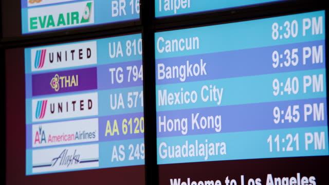 CU TD Arrival departure board at LAX