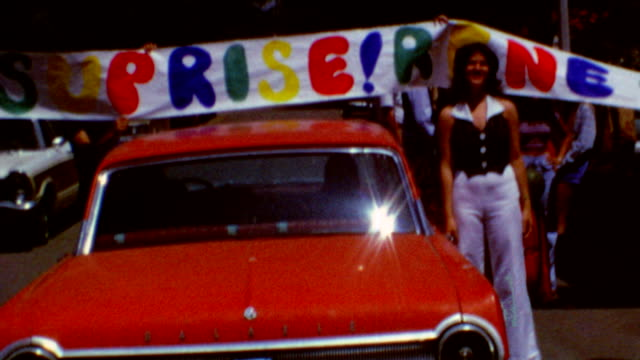Arrival of red BMW / Surprise / Entering home for party / Surprise BMW on June 24 1972 in Santa Monica California