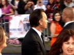 Arrivals at 'Mamma Mia' film premiere Actor Tom Hanks and wife Rita Wilson as interviewed by press / Hanks along to sign autographs for crowd as...