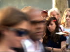 Arrivals at 'Mamma Mia' film premiere Back view Stellan Skarsgard signing autographs for fans