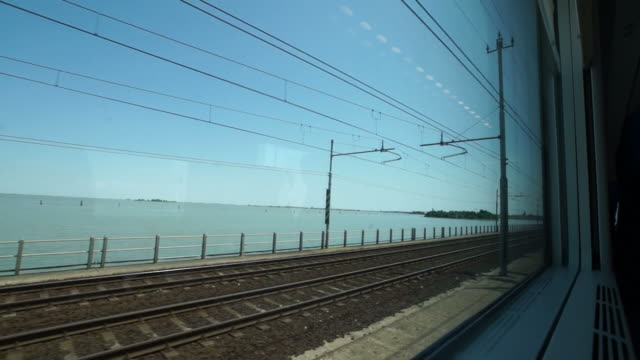 Arriving by train in the Venetian lagoon, Italy