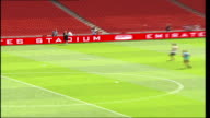 Arsenal Emirates Stadium previewed to fans High angle general view of players on pitch / Fans in seats with roof visible PULL OUT players on pitch /...
