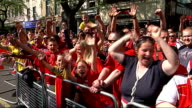 London Islington EXT Arsenal fans lining victory parade route/ vox pops/ variosu of Arsenal fans waving flags and cheering/ vox pops/