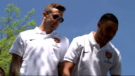 Arsenal FA Cup victory parade **Pop Music heard over following** Various of Arsenal players waving to fans from opentopped bus and holding aloft FA...