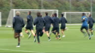 Arsenal FC training ahead of Champions League match ENGLAND Hertfordshire London Colney EXT Various of Arsenal footballers warming up and kicking...
