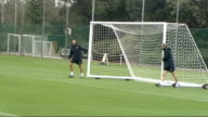 Arsenal FC training ahead of Champions League match Wenger along and helping to move goal post / more of Arsenal players training including Chamakh...