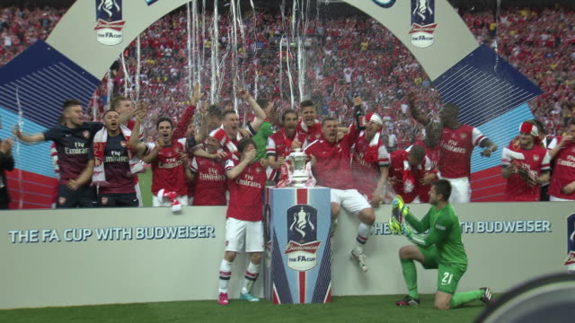 Arsenal first team celebrate on the pitch at Wembley Stadium after becoming FA Cup champions for the 11th time after beating Hull City