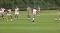 Hertfordshire London Colney EXT General views Arsenal FC training session including shot of Arsene Wenger / exterior of building with logo 'Arsenal...