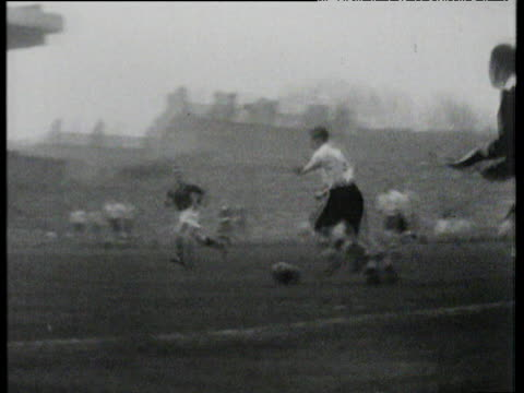 Arsenal number 11 Denis Compton crashes left foot shot in off both posts to score Highbury 1940's