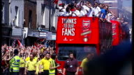 Arsenal parade to celebrate FA Cup win **Music heard SOT** Arsenal players along on top of double decker bus during parade / crowd cheering