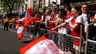 Arsenal parade to celebrate FA Cup win **Music heard SOT** Fans behind barrier waving flags