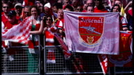 Arsenal parade to celebrate FA Cup win **Music heard SOT** People holding flags and banners