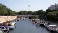 Arsenal Port in Paris France where Seine river and SaintMartin canal link In the background the column of July at Place de la Bastille